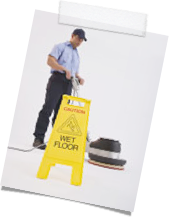 Cleaning Man using Floor polisher for Floor Maintenence and wet Floor sign.